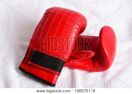 Bright Red Boxing Gloves On White Towel Background, Close Up