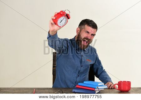Man With Beard Holds Red Alarm Clock Isolated On White