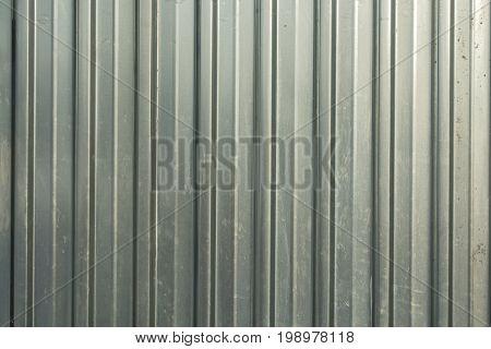 Corrugated iron of aluminum on a facade. Background image.