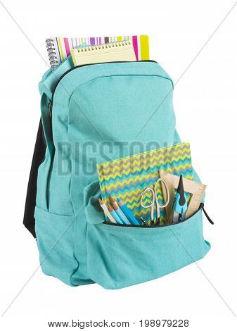 Backpack full of school supplies isolated on white background