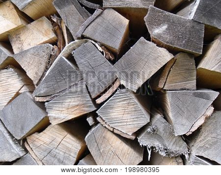 Is the firewood stacked in the woodpile.