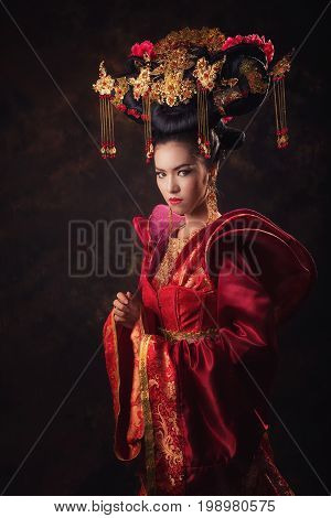 Woman in Chinese tradition dress. Queen red dress