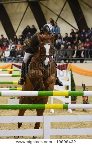 KAPOSVAR, HUNGARY - MARCH 27: Attila Tecsy jumps with his horse (Peron) on the Masters Tournament International Jumping Competition, March 27, 2011 in Kaposvar, Hungary