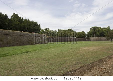 LUCCA, ITALY - AUGUST 15 2015: Walls surrounding the fortified city of Lucca in Tuscany