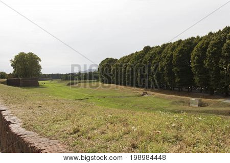 LUCCA, ITALY - AUGUST 15 2015: Field surrounding Lucca ancient walls in Italy