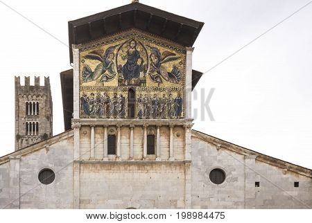 LUCCA, ITALY - AUGUST 15 2015: Architectural close up of the upper facade of Ancient Basilica of San Frediano in Old Lucca town Italy