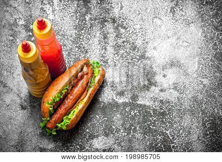 Street Food. Hotdog Beef With Greens In A Fresh Bun.