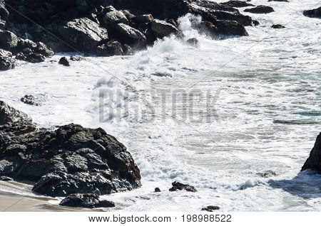 Central California Coast With Beach, Cliffs And Blue Ocean In Big Sur With Waves Crashing