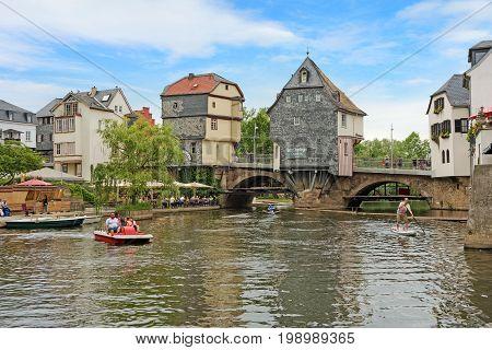 Bad Kreuznach Germany - June 17 2017: Inner city of Bad Kreuznach river Nahe with old famous buildings and bridge