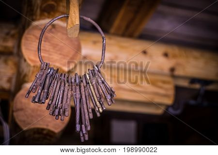 Old metal rusty keys hang on the ring