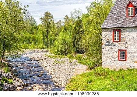 Stone Cottage Colorful House By River On Chemin Du Roy In Quebec, Canada