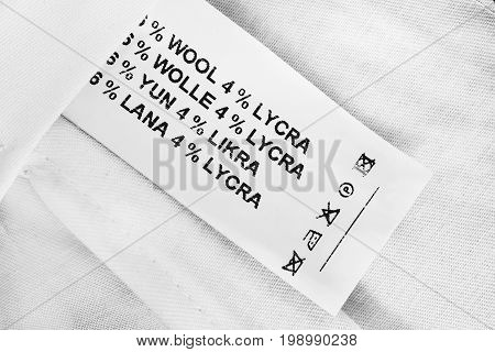 Fabric composition and washing instructions clothes label on white cloth