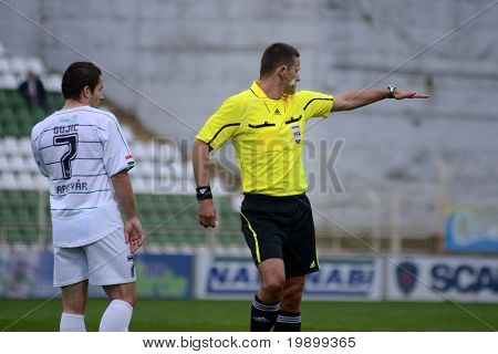 KAPOSVAR, HUNGARY - APRIL 16: Ando-Szabo (referee) in action at a Hungarian National Championship soccer game - Kaposvar vs MTK Budapest on April 16, 2011 in Kaposvar, Hungary.