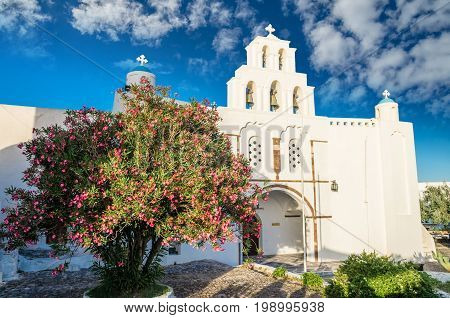 Pyrgos, Santorini island, Greece. Cycladic traditional village with blue domes of churches and white houses.