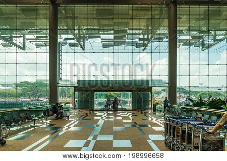 Visitors Walk In Entrance Departure Hall In Changi Airport Singapore