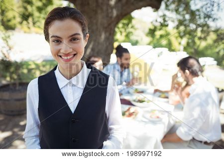 Portrait of smiling waitress in restaurant