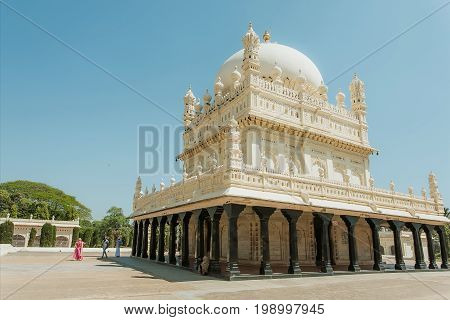 SRIRANGAPATNA, INDIA - FEB 18, 2017: Great example of Mughal architecture building of Tipu Sultan Gumbazigh with white roof on February 18, 2017. Park with the 18th century Muslim mausoleum.