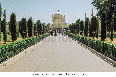 SRIRANGAPATNA, INDIA - FEB 18, 2017: Alley to the great example of Mughal architecture building of Tipu Sultan Gumbazigh on February 18, 2017. Park with the 18th century Muslim mausoleum.