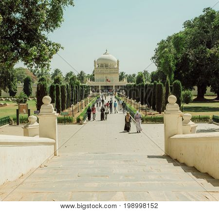 SRIRANGAPATNA, INDIA - FEB 18, 2017: Royal alley to the great example of Mughal architecture building of Tipu Sultan Gumbazigh on February 18, 2017. Park with the 18th century Muslim mausoleum.