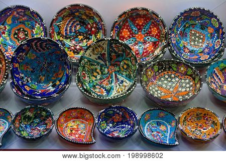 SIDE TURKEY - JULY 07 2015: Souvenir shop on the waterfront. Plates with the traditional pattern of folk motives. Anatolian coast - a popular holiday destination in summer of European citizens.