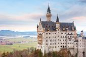 World-famous tourist attraction in the Bavarian Alps, fairytale Neuschwanstein or New Swanstone Castle, the 19th century Romanesque Revival palace at sunset, Hohenschwangau, Bavaria, Germany poster