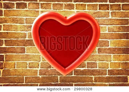 red photo frame on old brick wall