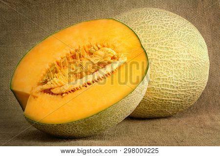 Melon And Half On Sackcloth (studio Shoot Image)
