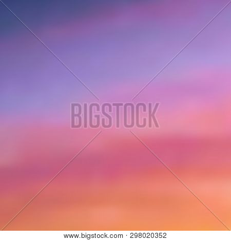 Beautiful Blurred Background In Warm Purple-pink And Orange Tones, Sunset Sky With Light Dusting Of