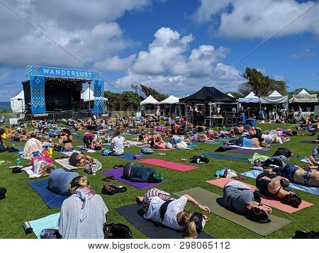 North Shore, Oahu - March 2, 2019: Roll To The Side As They Awake From Savasana At Wanderlust Mc Yog
