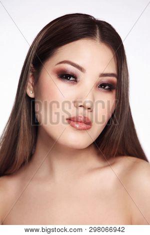 Portrait of young beautiful asian girl with smoky eye makeup