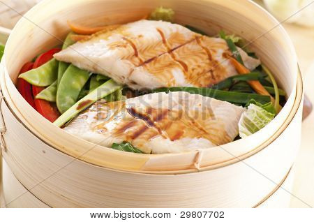 Fish with vegetables steamed poster