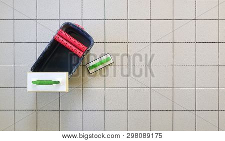 Top View Of Tools For Grouting Ceramic Tiles. Tilers Using A Rubber Trowel And Sponge