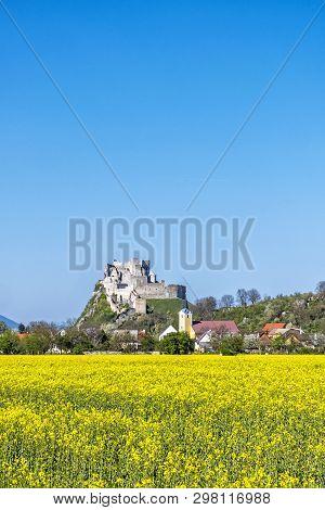 Beckov Castle With Oilseed Rape Yellow Field, Slovak Republic, Europe. Travel Destination. Seasonal
