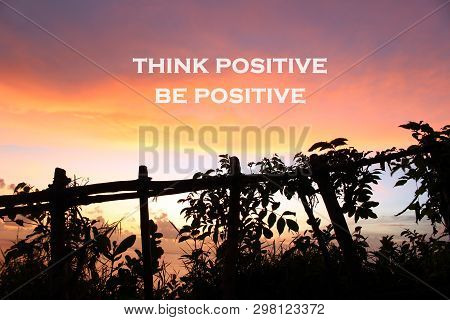 Inspirational Motivational Quote- Think Positive, Be Positive. With Natural Wooden Fence And Wild Pl
