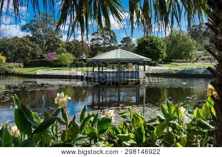 Tropical Park With Summerhouse Near The Pond And Lush Green Trees And Flowers. Wollongong Botanic Ga