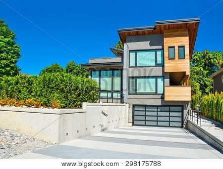 Modern Residential House With Emotion Element In Design On Blue Sky Background. Detached House With