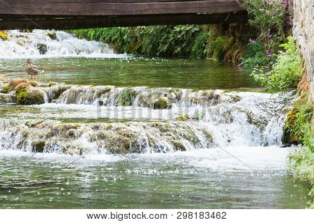 Krka, Sibenik, Croatia, Europe - A Wooden Bridge Leading Over Some River Cascades