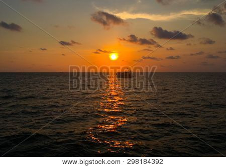 Beautiful Sunset Over Open Sea With Solar Way And Tourist Boat Silhouette At Phu Quoc Island, Vietna