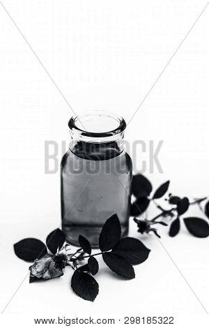 Rose water or rosa water isolated also known as gulab jal or gulab ka pani isolated on white. poster