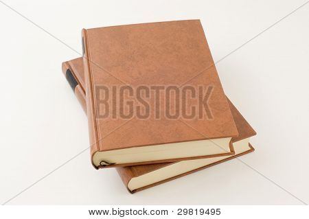 Two thick books on white background.