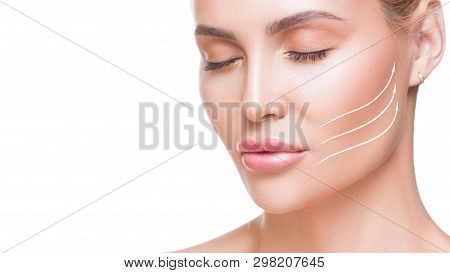 Portrait Of Attractive Woman With Arrows On Her Face Over White Background. Face Lifting Concept. Pl