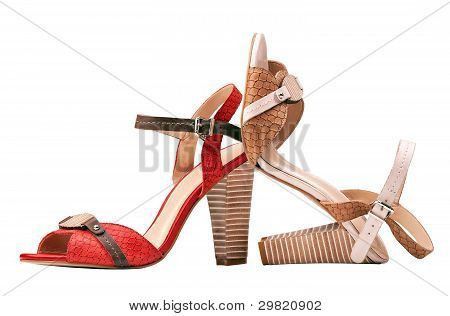 Two female summer shoes over white, with path