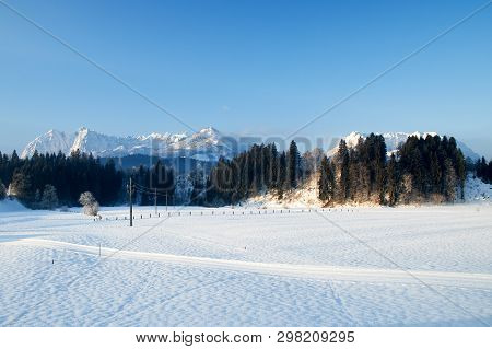 The Wild And The Tame Emperor Of The Kaiser Mountains In Tyrol Austria Snow Covered Next To Each Oth