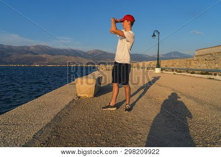 Young Man Looks In The Setting Sun