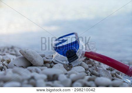 Diving Mask Lies On A White Stone Beach