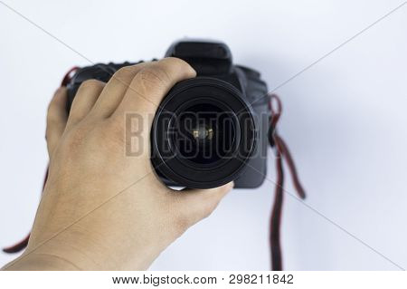The Camera In The Hands Of The Photographer On A White Background. Shoot At An Old Slr Camera In The