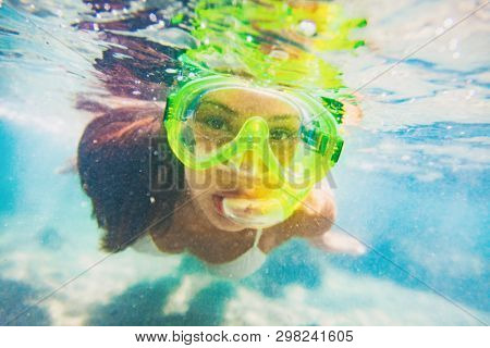 Snorkel water sport activity young Asian woman swimming underwater with snorkeling mask on Caribbean travel vacation having fun. Beach watersport active lifestyle.