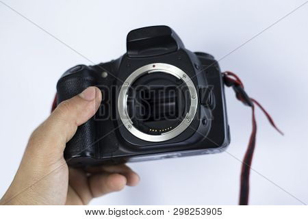 The Body Camera In The Hands Of The Photographer On A White Background. Shoot At An Old Slr Camera I