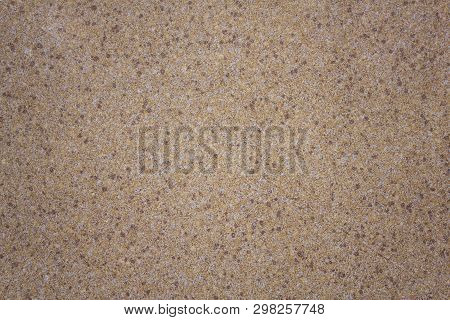 White Gray Granular Surface Of The Wall With Yellow, Red And Black Dots. Rough Texture