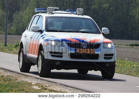 Amsterdam, The Netherlands: April 22nd 2019: Dutch Police Car On Surveillance Near Polderbaan Runway